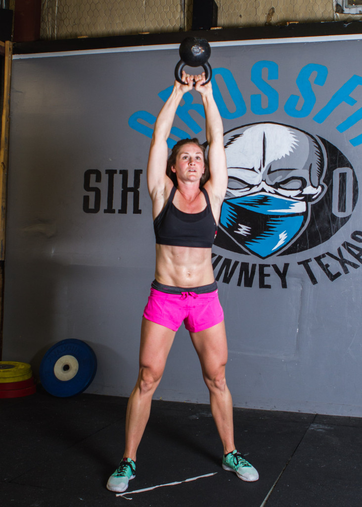 crossfit woman kettlebell swing